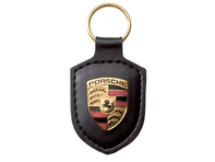 Porsche key ring metal crest on black leather strap , with metal ring