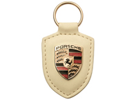 Porsche crest key ring in cream , with metal ring